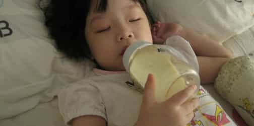 Should my baby go to bed with a bottle?