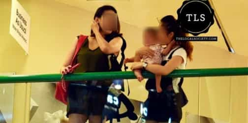 Woman allegedly rests her baby dangerously at the edge of shopping mall railing