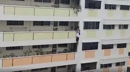 Maid dangling off fifth-floor railing in Bukit Panjang pulled to safety