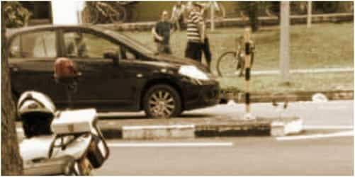 Singapore school boy hit by car while using pedestrian crossing