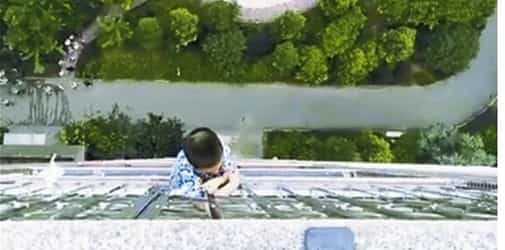 5-year-old boy dangles from 19th floor balcony, showing need for high-rise safety awareness