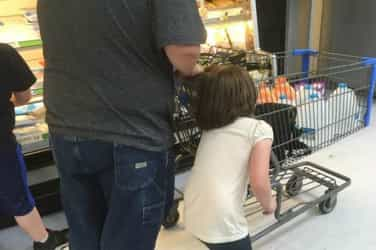 Father disciplines daughter by dragging her by the hair around supermarket