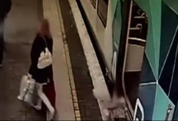 Watch: Child falls in between the train and platform while mom walks ahead
