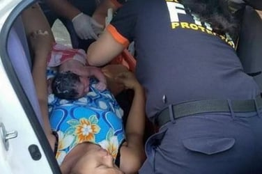BREAKING NEWS: Woman gives birth in a taxi along busy street in Quezon City
