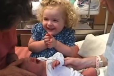 This girl does the sweetest thing to calm her baby sister