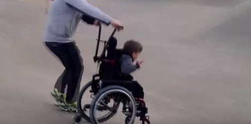 Boy in a wheelchair experiences 'skateboarding' for the first time thanks to his dad