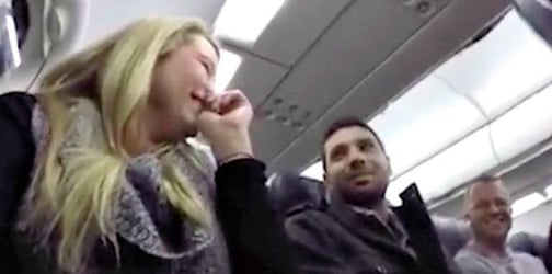 Woman surprises her husband with pregnancy announcement while aboard a plane