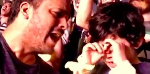 Boy with autism gets emotional watching his favorite band Coldplay for the first time