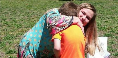 High schooler makes 8-year-old leukemia patient her prom date