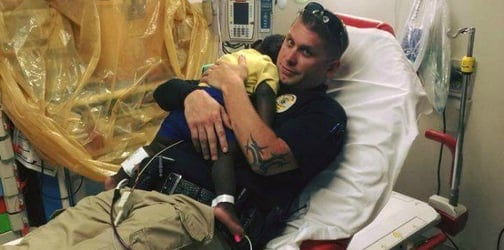 Officer comforts crying toddler found wandering streets