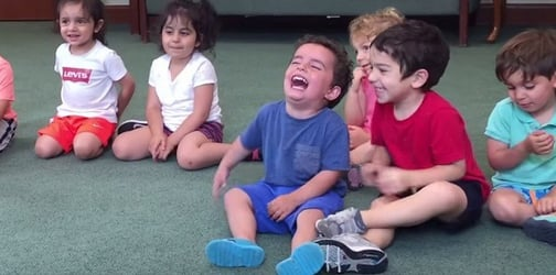 Hilarious: Little boy can't stop laughing in music class