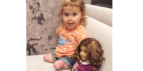 Quadruple amputee receives look-alike doll for her birthday