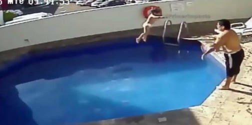 Stepfather drowning little girl in a hotel pool caught on CCTV footage