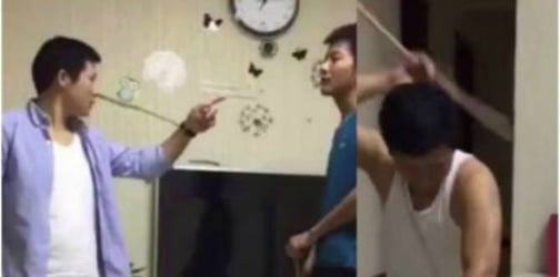 Father punishes son by lashing his own back