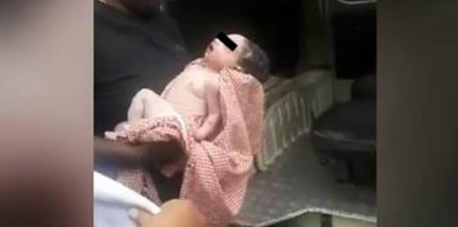 Unwanted newborn flung from building by his mother, clings to life