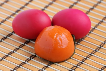 The Origins Behind The Symbolic Red Egg And Ginger Party