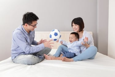 Choosing baby toys and games to promote growth