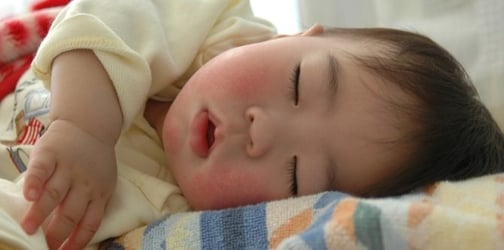 Baby Sweats While Sleeping? Here's What You Need to Know