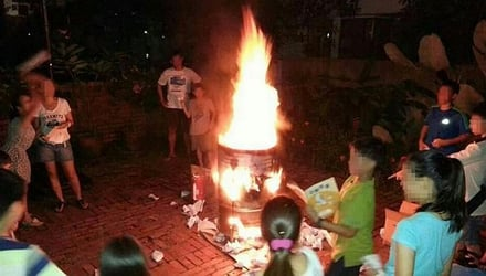 Children and their parents burn books after PSLE exams
