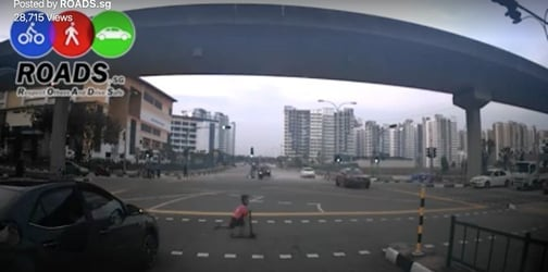 OMG! Little boy on kick scooter hit by taxi in Singapore!