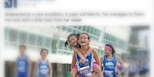 """This picture of Singapore's """"piggyback sisters"""" will inspire you to never give up!"""