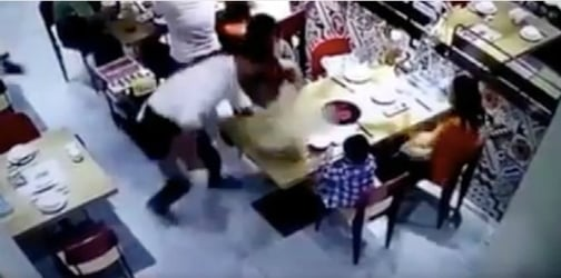 Boy scalds as a waiter accidentally slips and pours hot broth over him