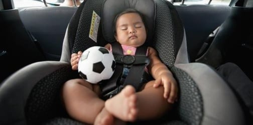 Child falls out of moving car despite being strapped in car seat