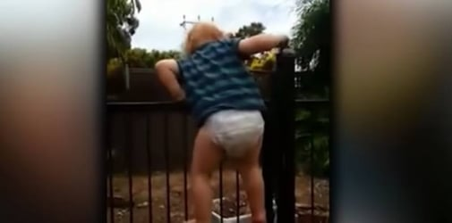 Toddler climbs over pool fence, reminding us to never take safety for granted