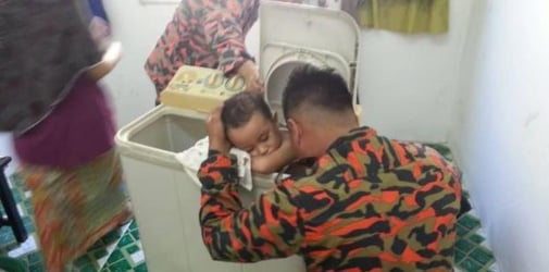 3-year-old child gets trapped inside top-loading washing machine