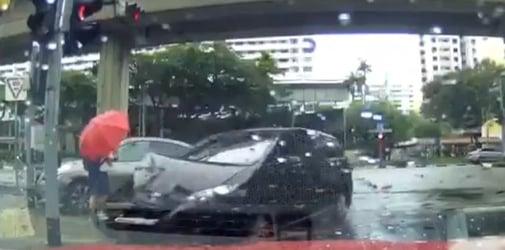 Heart-stopping video shows Singapore schoolboy nearly hit by cars TWICE