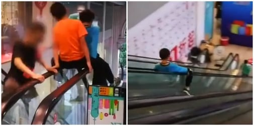 3 Boys slide down escalator handrails in mall as adults cheer them on