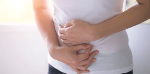 What Causes Endometriosis Bloating? New Study Says Genetics May Have The Answer!