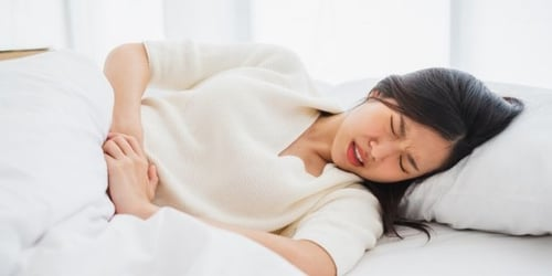Implantation Cramps Or A Regular Period: Here's How To Tell The Difference