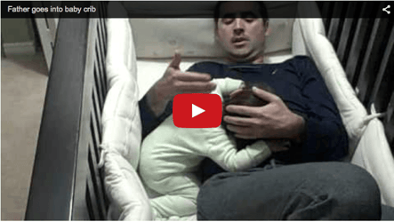 Funny baby video- Father sleeps in baby's crib!