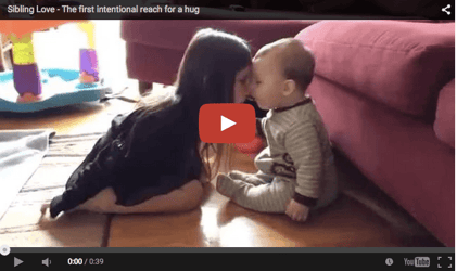 Cute baby video: Siblings reach out for a hug