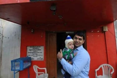 Hats off: 28-year-old Indian bachelor adopts child with Down's Syndrome