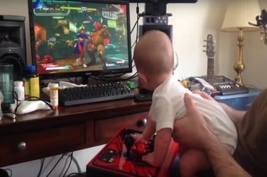 Six-month-old is as good a gamer as his dad