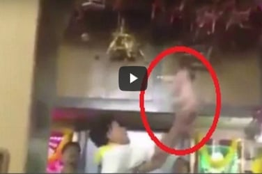 Shocking Indian ritual shows a newborn baby being tossed in the air like a doll!