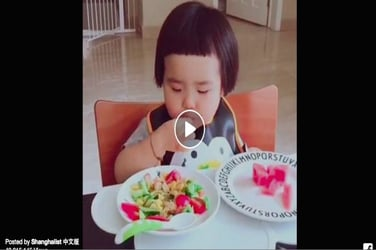 This little girl eating to the tune of Daler Mehendi's Tunak Tunak tun is the cutest thing you'll see today!