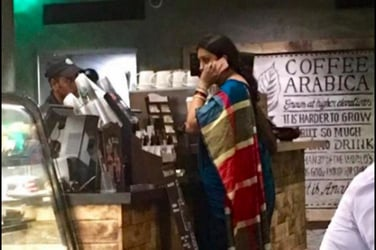 This image of Smriti Irani standing in line for a coffee is the coolest thing you will see today!