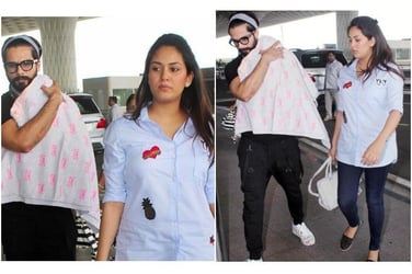 How cute! Little Misha's day out with daddy Shahid and mummy Mira!