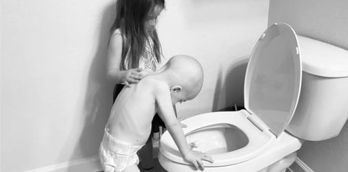 Sad Photo Shows Sister Comforting Little Brother With Cancer