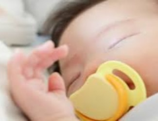 My baby uses a pacifier to sleep. At what age should I take it away?