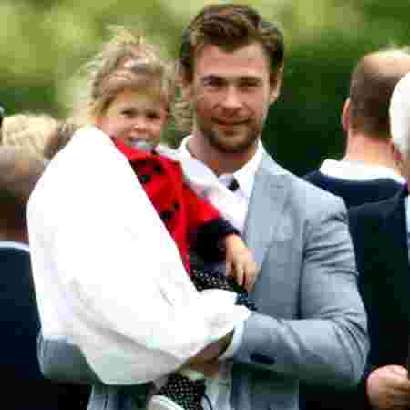 Chris with India Rose at a 2015 Polo Match (Kate Middleton and Prince William were also in attendance)