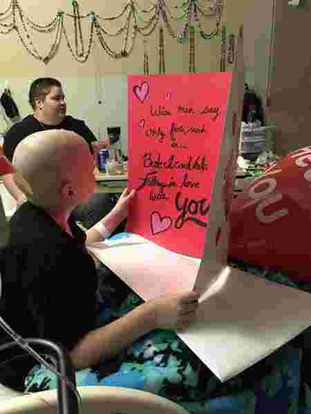 (Source: Jennifer Usiak) Lucas reading a card Stella composed and sent him.