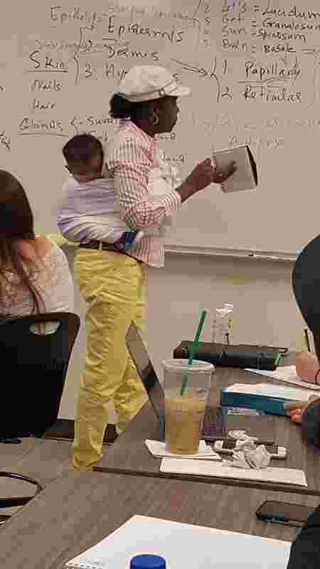 Professor carries her student's baby for 3 hours so she can learn in class