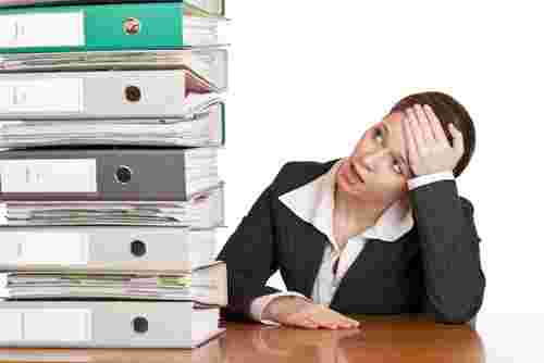 woman overwhelmed by work