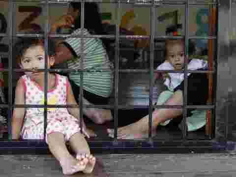 Children at the Lenggeng detention center, south of Kuala Lumpur, Malaysia, face the possibility of being sold into slavery as a result of over-crowding.AP Photo/Mark Baker