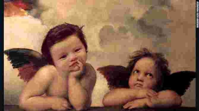 Little Isabelle has the best head of hair of all humans...and cherubs!