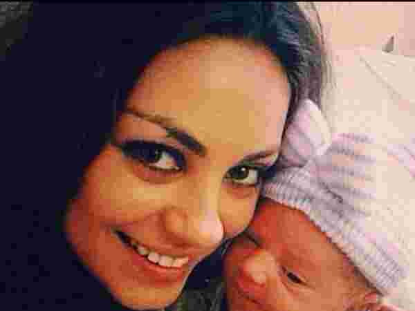mila with baby selfie